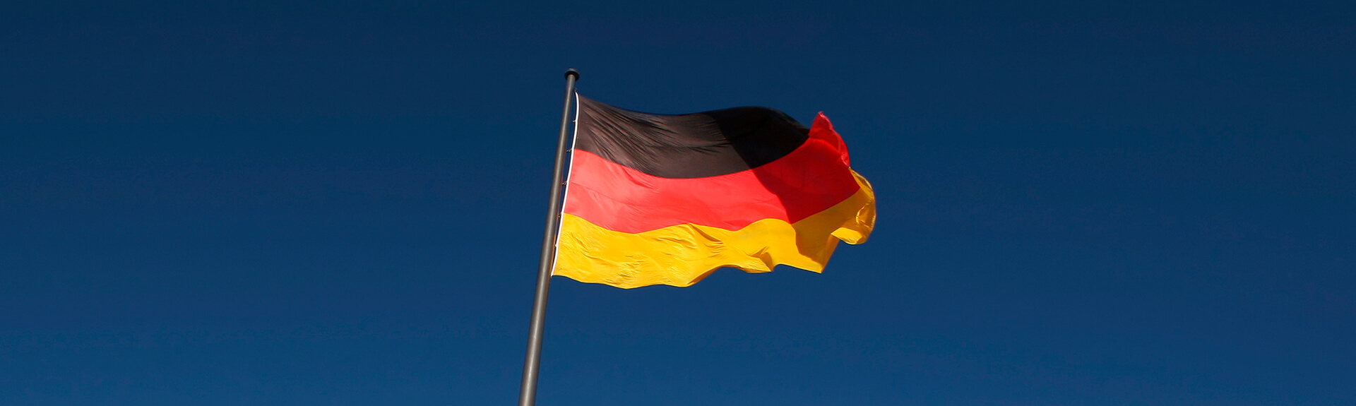 German flag on blue sky