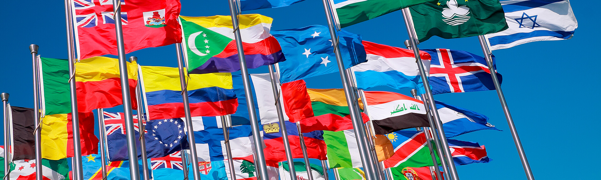 Flags of different world nations on blue sky
